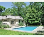 PRIVACY AWAITS YOU IN THIS EAST HAMPTON FRENCH STYLE HOME